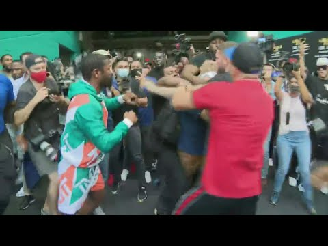 Floyd Mayweather & Jake Paul Get Into Tussle Over Hat At Exhibition Fight Presser In Miami MQ quality image