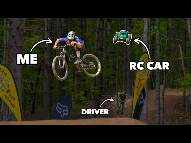 What could go wrong? Riding mountain bikes with an RC car HQ quality image